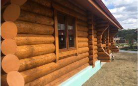 Покраска деревянного дома и бани
